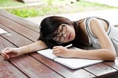 21356824-beautiful-asian-student-woman-tired-and-sleep